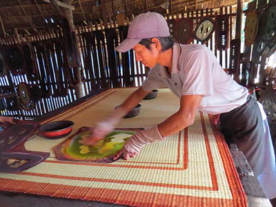 Behind the colorful mat weaving